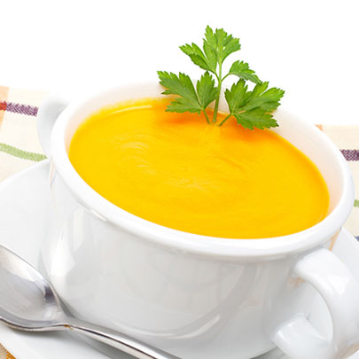 PediaSure® recipe of a carrot ginger soup garnished with cilantro