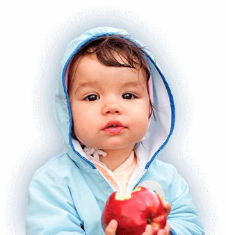 PediaSure® image of a child that has bit into a red apple