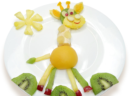 PediaSure® image of a giraffe on a plate made of various fruits