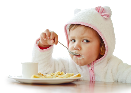 PediaSure® image of a child enjoying oatmeal