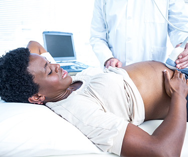 A lady getting an ultrasound by doctor
