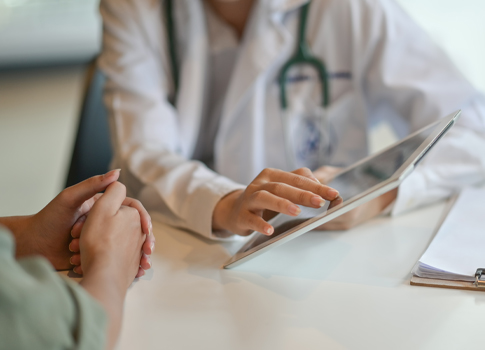 A patient consulting with a physician, with a zoomed in view of their hands