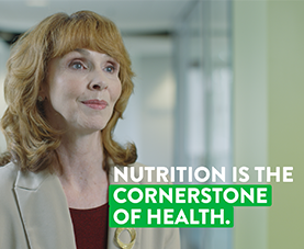 "A frame of Rachel Buck discussing nutrition with the caption ""nutrition is the cornerstone of health."""