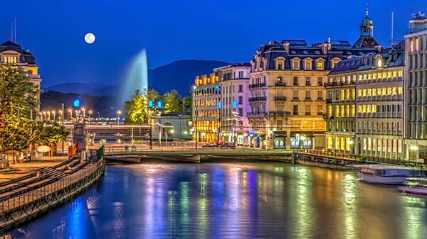 An urban, evening view of Geneva, Switzerland