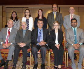 Ten speakers from the Malnutrition Blood Biomarkers Roundtable pose for a photograph.
