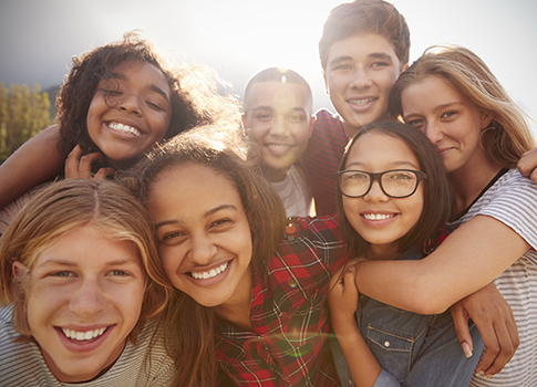 A group of smiling teenagers.