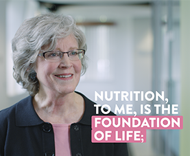 "A frame of Melody Thompson discussing nutrition with the caption ""nutrition, to me, is the foundation of life."""