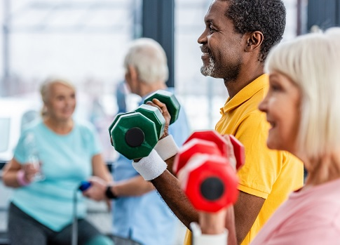 Older people lifting hand weights