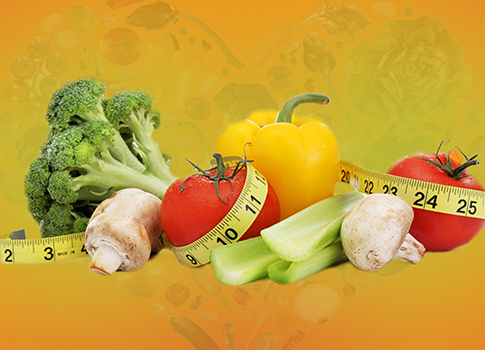 A selection of fruit and vegetables with a tape measure.