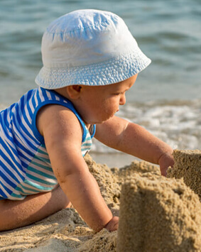 banner-baby-boy-playing-on-the-beach - Copy