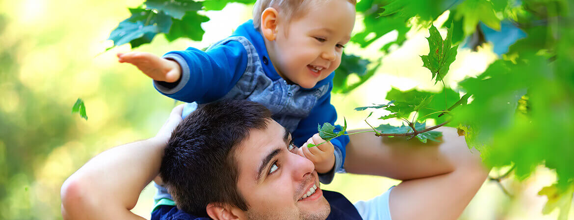 banner-father-and-son-having-fun-playing-outdoor