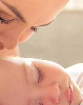 banner-mom-is-kissing-her-cute-little-baby - Copy