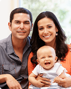 banner-new-parents-posing-with-their-infant-daughter