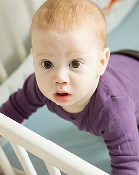 callout-baby-boy-trying-to-stand-up-in-his-cot