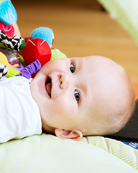 callout-baby-playing-with-colorful-toys