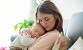 young mother holding newborn baby boy - Thumbnail