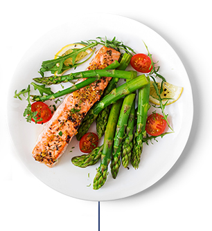 A plate of roasted salmon with cherry tomatoes and asparagus