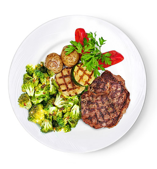 Roasted broccoli, zucchini, grilled steak, and roasted potatoes