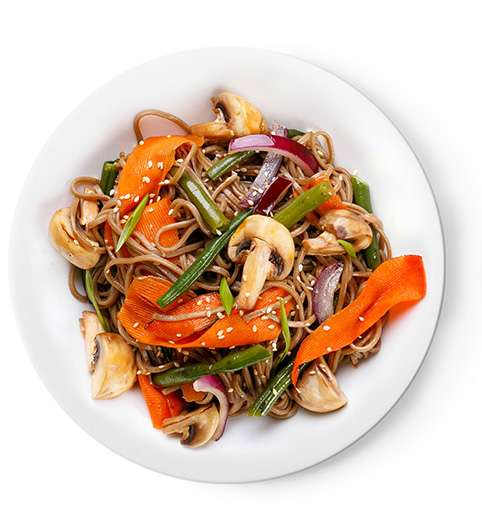 Brown rice noodles, mixed stir-fried vegetables, and tofu cubes