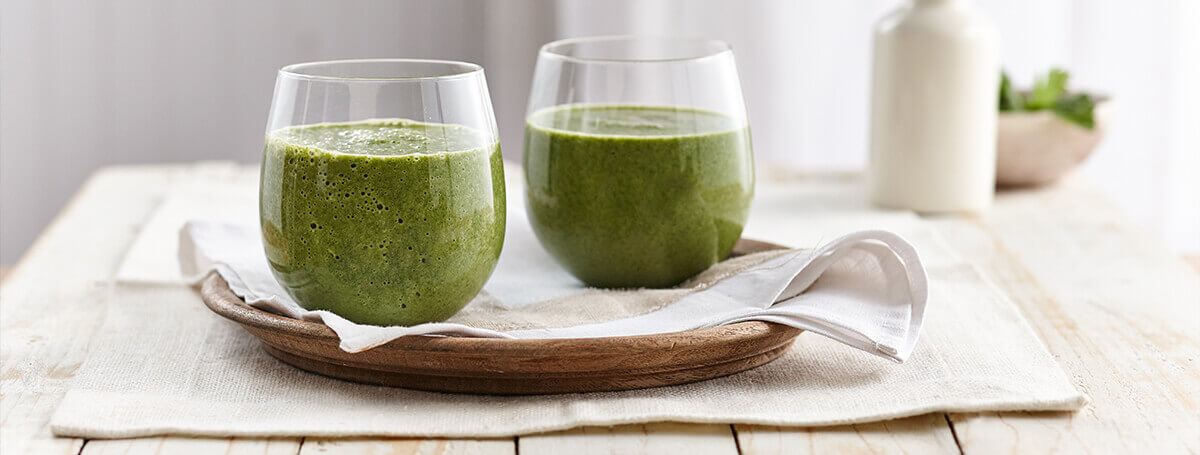 Green spinach smoothie recipe made with Vanilla Ensure® Enlive®