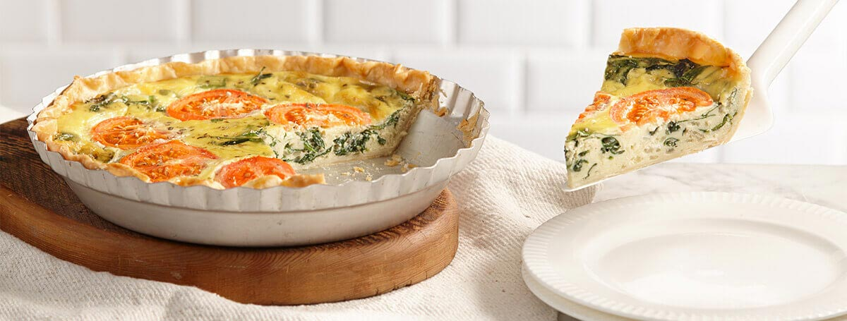 Spinach quiche recipe made with Ensure® Regular with tomatoes on top