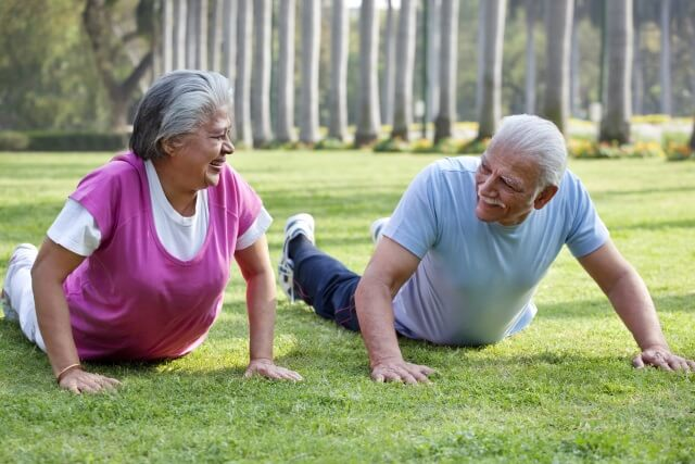 elderly couple excersing