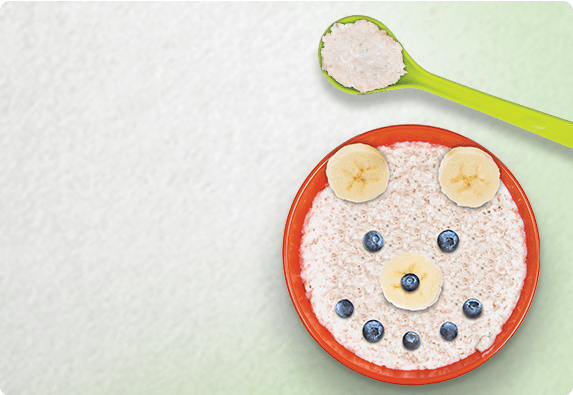 A Young Kids Spoon And Bowl With Food In The Shape Of Happy Smile Five Fun