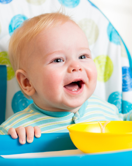 banner-smiling-baby-eating-food